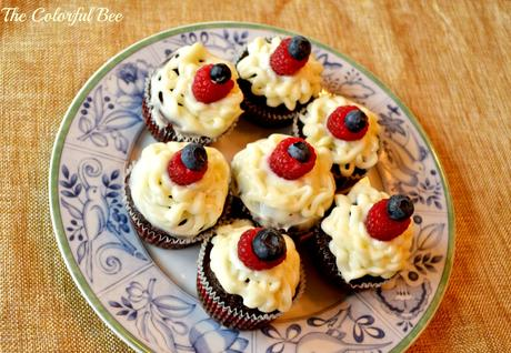 devil's food chocolate cupcakes with cream cheese icing and blueberry and rasperry decoration