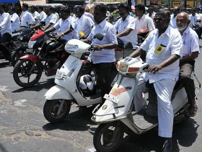 Section of Madurai Advocates defy helmet rule - protest by holding rally