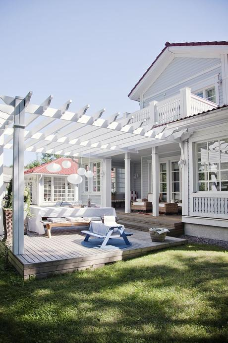 WOW! I love the nook to the back left, the pergola for shade (And hanging plants) and the cozy feel this deck has!