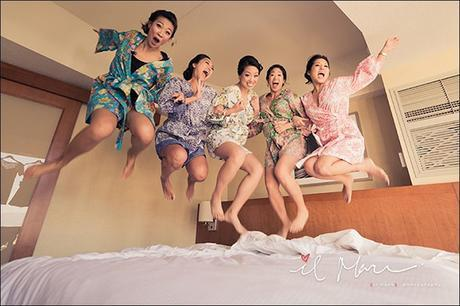 Bridesmaids Getting Ready Jumping on Bed