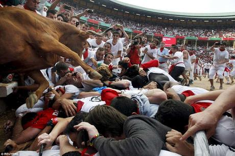 Russian leaflet on Selfie ban .... mad people at Pamplona bull capture !!!
