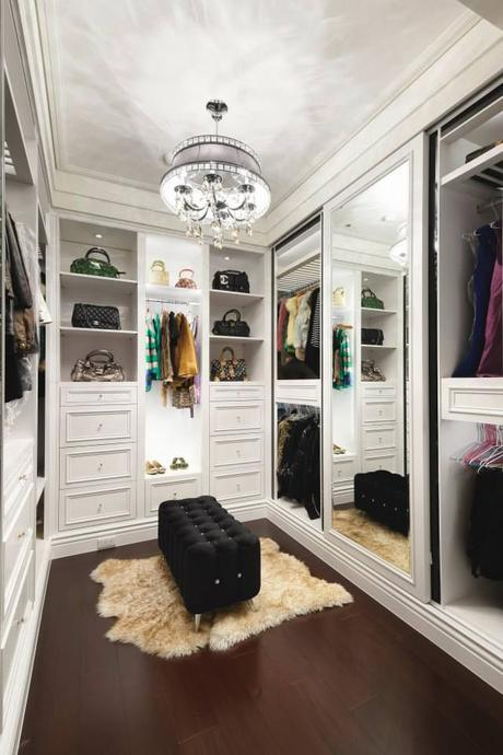 Lovely white walk-in closet with a mirror doors. Home ideas at: http://www.homechanneltv.com/