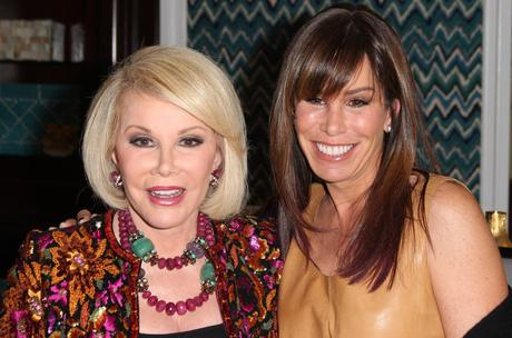 PASADENA, CA - JANUARY 07:  TV personalities Joan Rivers (L) and Melissa Rivers speak during the E! Entertainment Television lunch panel during the NBCUniversal portion of the 2012 Winter TCA Tour at The Langham Huntington Hotel and Spa on January 7, 2012 in Pasadena, California.  (Photo by Frederick M. Brown/Getty Images)