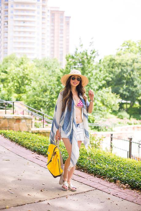 chic at every age, beach swimsuit coverup, how to wear a poncho, TOMS yellow backpack, gold metallic slides, pantropic straw hat, urban outfitters striped open poncho, missoni mare reversible bikini