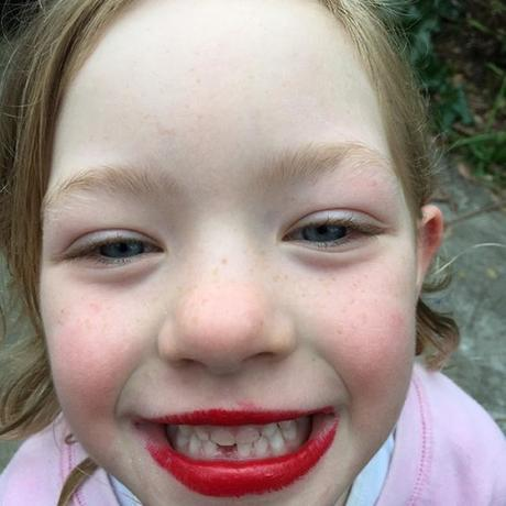 She is so happy her tooth finally fell out. The red lippy was for a disco birthday party the kids were off to on the weekend.