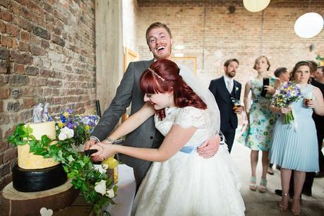Barmbyfield Barn Wedding Photography Cake cutting