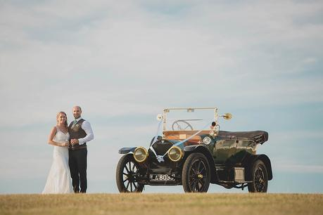Bride & groom & vintage car