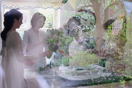 Bride & Bridesmaids making final flower pieces