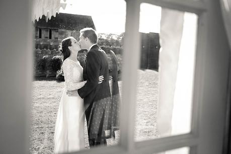 Bride & Groom candid kiss