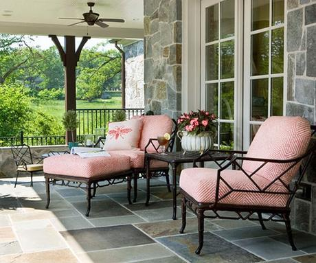 coral colored seat cushions on slate porch
