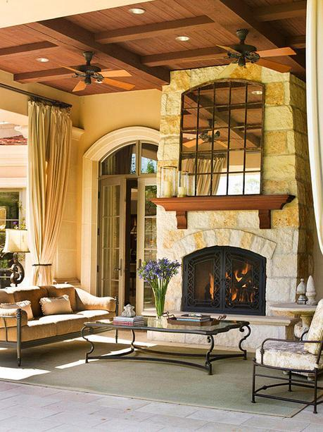 outdoor entertainment area with stone fireplace