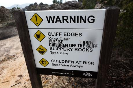 defaced sign throw children off the cliff grampians