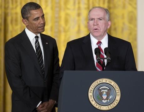 Barack Obama (l) and John Brennan (r) Photo by Joshua Roberts/Bloomberg via Getty Images