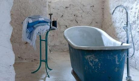 Three stylish bathtubs