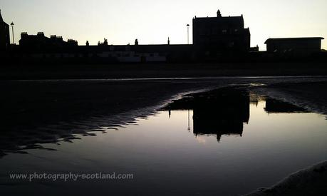 Photo - buildings on the front at Porobello, reflected in water on the shore, Edinburgh, Scotland