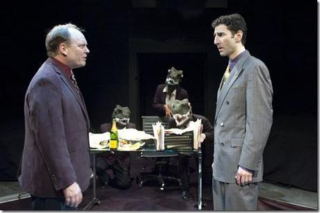 """Bret Tuomi as Jeffrey Skilling confronts Sean Fortunato as Andrew Fastow, with his """"raptors"""" (from left: Benjamin Sprunger, Demetria Thomas, and Matt Holzfeind) in the Chicago premiere of ENRON by Lucy Prebble, directed by Rachel Rockwell"""