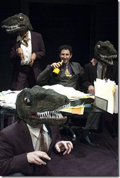 """Sean Fortunato as Andrew Fastow, with his """"raptors"""" (from left: Demetria Thomas, Benjamin Sprunger and Matt Holzfeind) in the Chicago premiere of ENRON by Lucy Prebble, directed by Rachel Rockwell"""