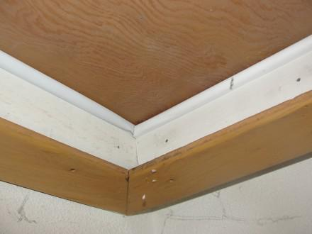 Weatherstripping at attic access panel