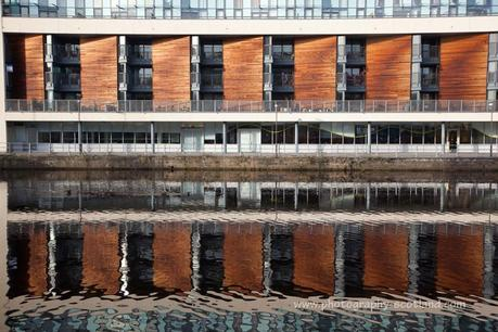 Photo - modern building reflected in the water of Leith, Edinburgh, Scotland