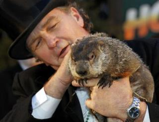 Punxsutawny Phil with handler, John Griffith: © Reuters /Jason Cohn