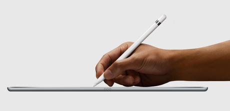 A hand using the Apple Pencil on the iPad Pro