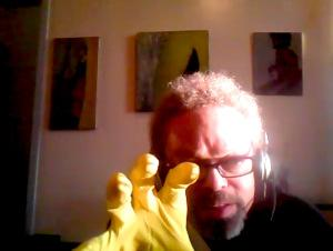 Calvin Wynter wearing a yellow rubber glove this morning