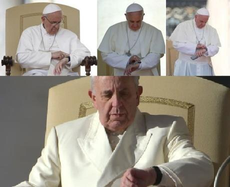 Pope Francis looks at his watch