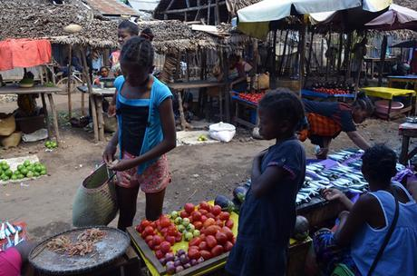 children selling vegetables