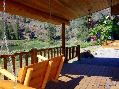 On the porch of our cabin at Quinn's Hot Springs Resort overlooking the Clark Fork River in Paradise
