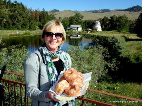 Happily holding a platter of huge doughnuts at Windmill Village Bakery in Ravalli