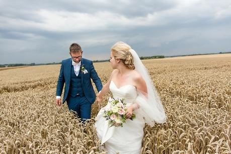 Barmbyfield Barn Wedding Photography couples portraits in field