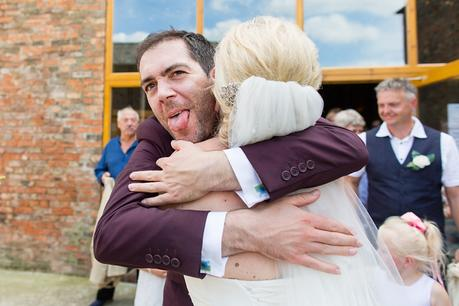 Canidid photographs at barmbyfiled barn wedding