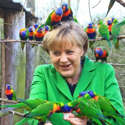 German Chancellor Angela Merkel ~lories parrots ... migrant crisis