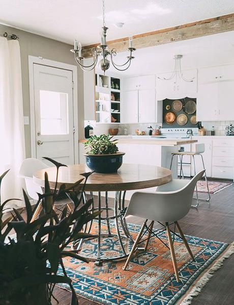 I love the idea of a small round table with two upholstered chairs instead of a table for 6.: