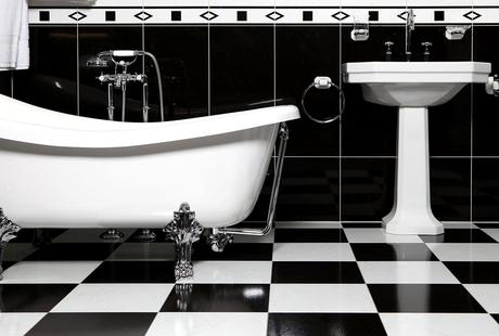 bathroom sink bath tub flooring black white remodel tips how to advice subfloor