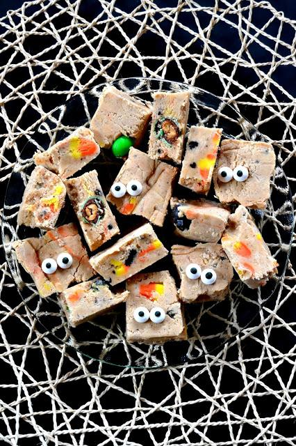 Fudge made with white chocolate and marshmallow creme packed with oreos, M&M's and candy corn