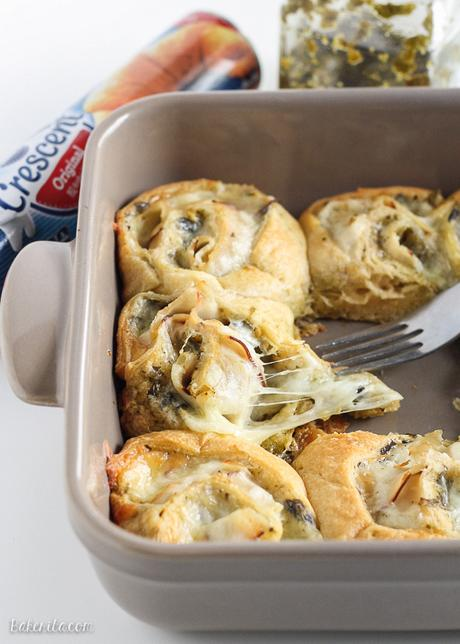 These Cheesy Turkey Pesto Rolls make a great snack or appetizer perfect for tailgating or the holidays! Gooey mozzarella makes this easy four ingredient recipe absolutely irresistible.