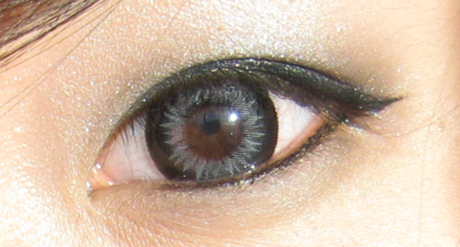 Grey colored lenses on brown eyes