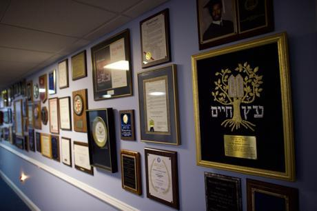 Another wall covered with awards and testimonials for speaking engagements