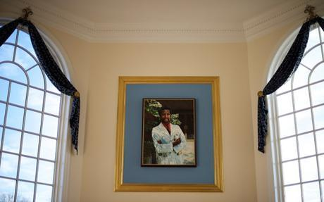 Painting of Carson over the fireplace in main lounge area