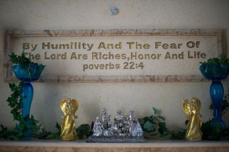 Quote from Proverbs chiseled on wall, with