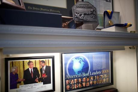 Framed pics of Carson receiving Medal of Freedom award from Bush, and cover of magazine featuring Carson.
