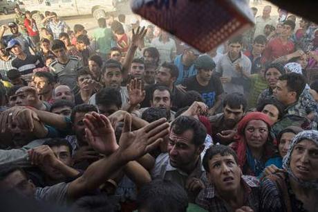 Syrian refugees (Photo credit: Lynsey Addario/NYT)