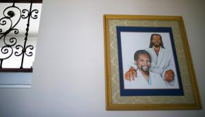 Painting of young Carson and Jesus in hallway
