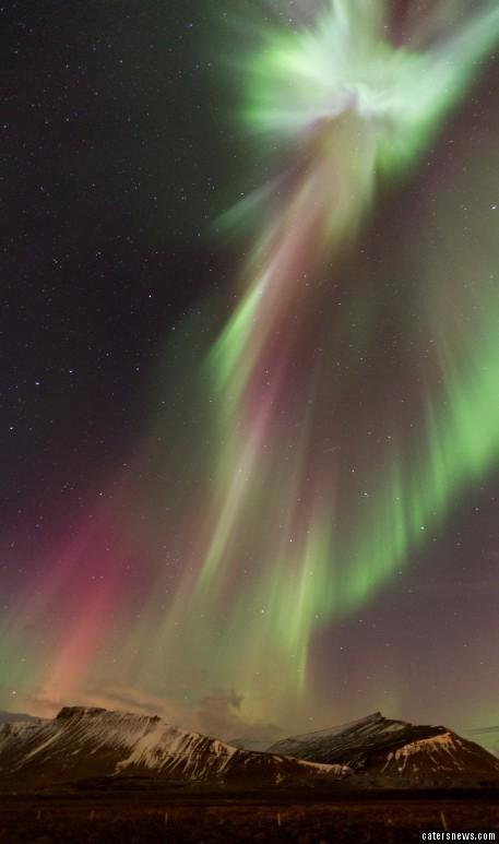 Christ in Northern Lights over Iceland (Photo by Jon Hilmarsson/Caters News Agency)