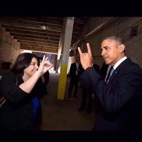 Obama makes devil sign