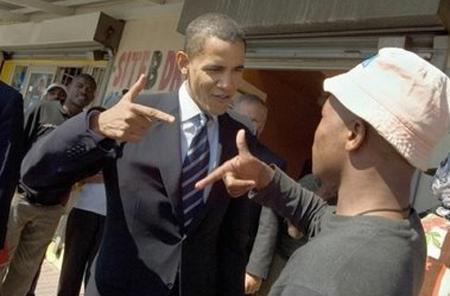 Obama makes gun gesture