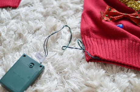 Want to win the ugly Christmas sweater party at the office? Just want to get in the Christmas spirit? Make your own DIY light up ugly Christmas sweater!- The Samantha Show