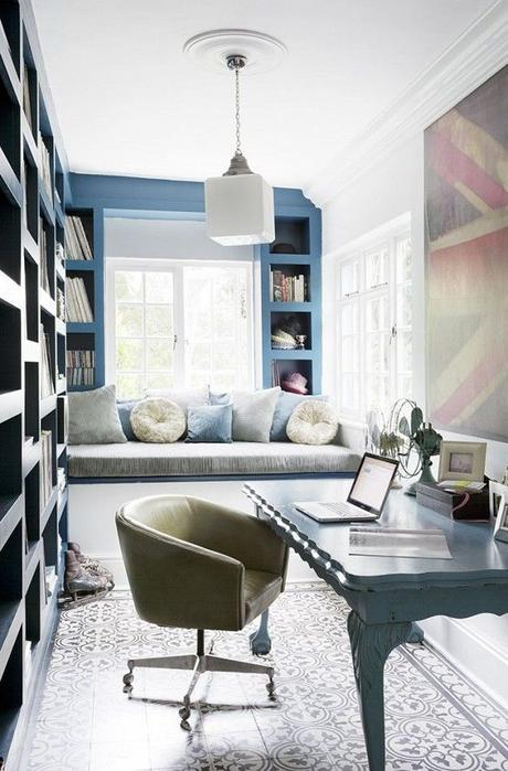 Narrow home office with window bench, modern light fixture, and large British flag art: