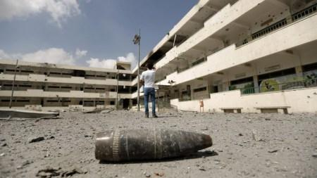A shell lies on the ground at the heavily damaged Sobhi Abu Karsh school in Gaza City's Shejaiya neighborhood, a Hamas stronghold, Tuesday, August 5, 2014. (Mohammed Abed/AFP)